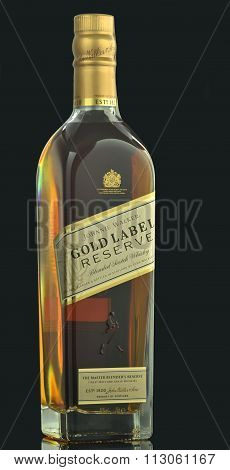Johnnie Walker Gold Label blended whisky isolated on dark background