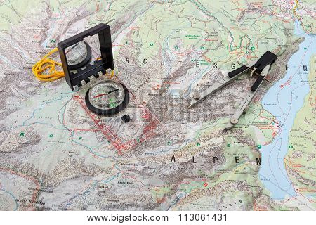 Compass and divider caliper on a hiking map of the Berchtesgaden Alps