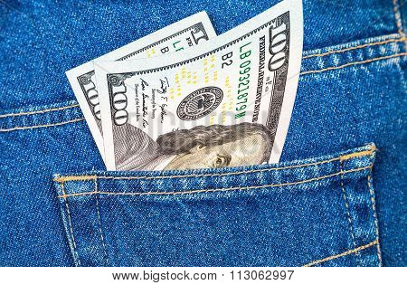 Banknotes Of One Hundred U. S. Dollars Bill Sticking Out Of The Back Jeans Pocket