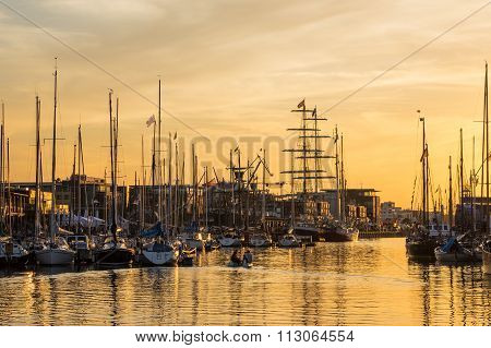 City Port In Rostock (germany) With Sailing Ships