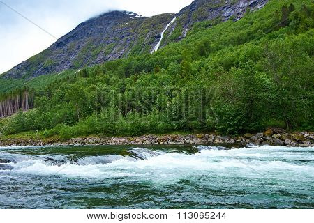 Mountain And River In Norway