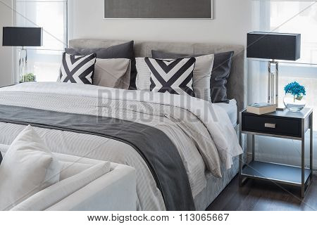 Modern Bedroom With White Bed And Black Lamp