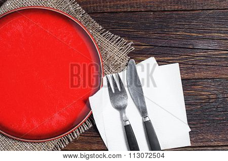 Empty Red Plate, Fork And Knife
