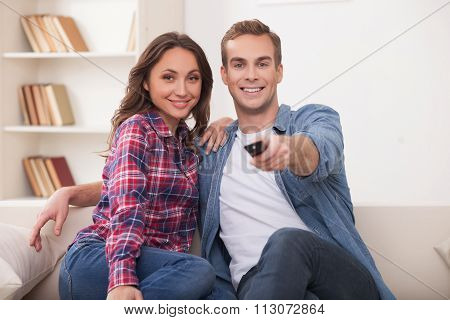 Attractive husband and wife are resting at home