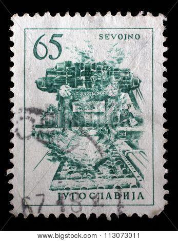YUGOSLAVIA - CIRCA 1959: A stamp printed in Yugoslavia shows steel plant in Sevojno a local community in western Serbia, circa 1959