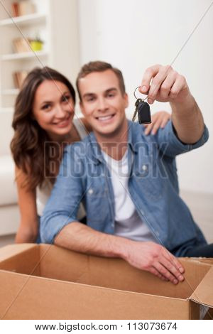 Attractive husband and wife are buying new house