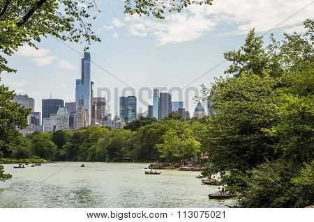 Lake In Central Park And New York City Skyline.