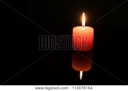 Light A Candle On Black Background