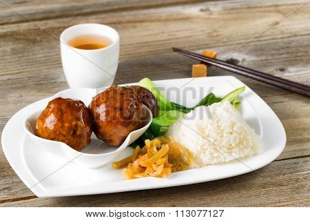 Saucy Meatballs Meal In White Plate Ready To Eat