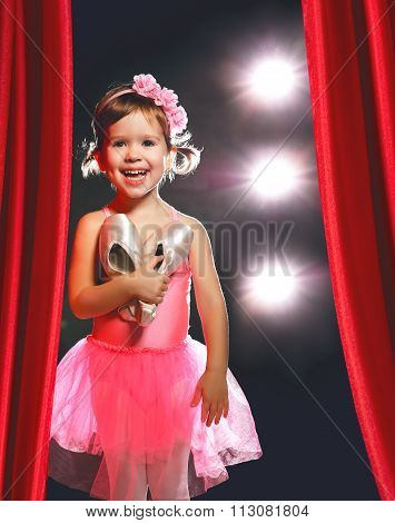 Little Girl Ballerina Ballet Dancer On Stage In Red Side Scenes
