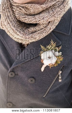 Boutonniere With Cotton Flower On Coat Of Groom
