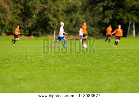 Blurred Soccer Players On Green Pitch