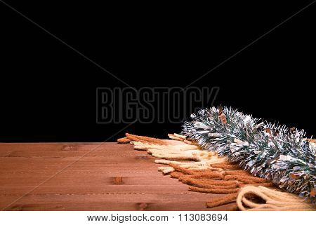 Fringe From A Plaid And Silver New Year's Tinsel On The Edge Of A Wooden Board