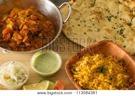 Vegetable pathia with rice and naan bread