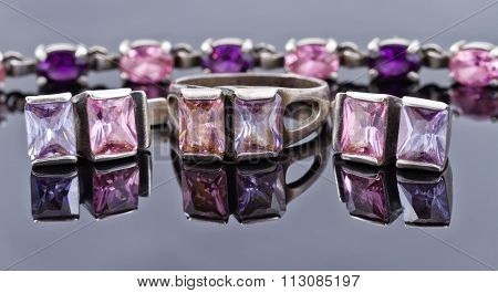 Carved Silver Ring With Earrings With Purple Gemstones
