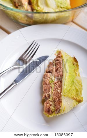 Fish Baked In Leaves Of Chinese Cabbage With Nuts And Lemon Juice