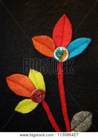 flowers made from felt that have buttons