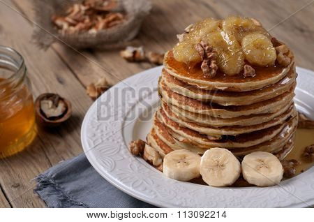Pancake With Caramelized Bananas, Nuts And Honey