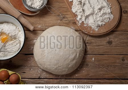 Fresh Dough On A Wooden Table In A Bakery