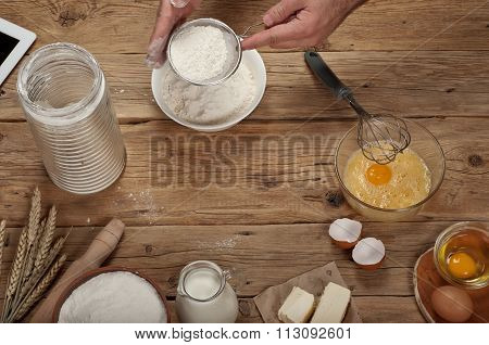 Male Chef Sifting Flour