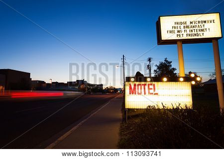 Generic Motel sign in the dusk on road