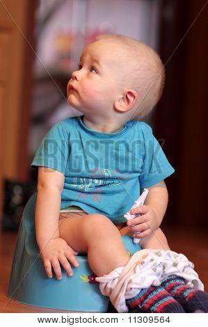 Child Is Sitting On Chamberpot