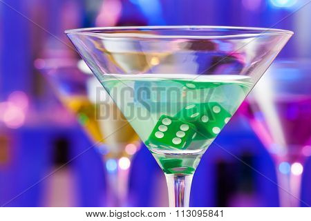 Close-up of cocktail glass with dice inside
