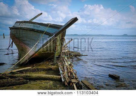 SANDAKAN,SABAH - DEC 27, 2015 : Abandoned fishing boat near pantai Pasir Putih, Sandakan,Sabah.