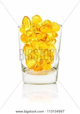 Fish Oil Capsules In Glass Isolated On White Background