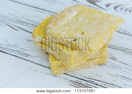 Moldy Bread On White Table Wood