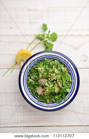 Tabbouleh - a bowl of fresh  middle-eastern salad.