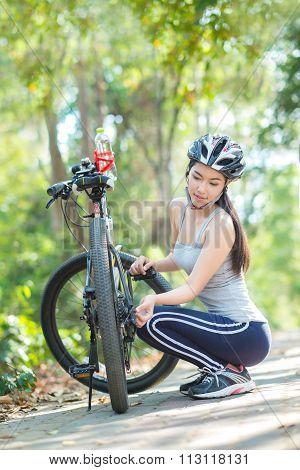 Woman Repairing Bike..