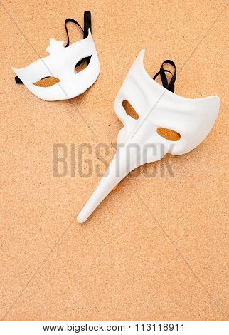 Two White Masks On Cork Wooden Background