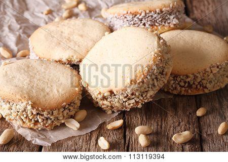 Cookies Alfajores With Cream On Paper Close-up. Horizontal
