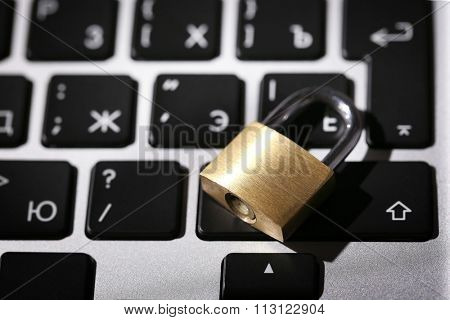 Cyber safety concept - lock on computer keyboard