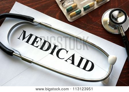 Paper with Medicaid and stethoscope.