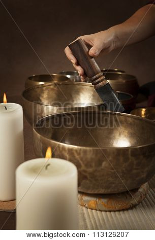 Woman Playing Tibetan Singing Bowl Close-up
