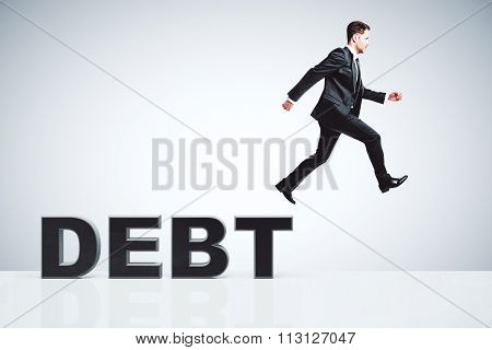 Debt Concept With Businessman Escapes From Debts