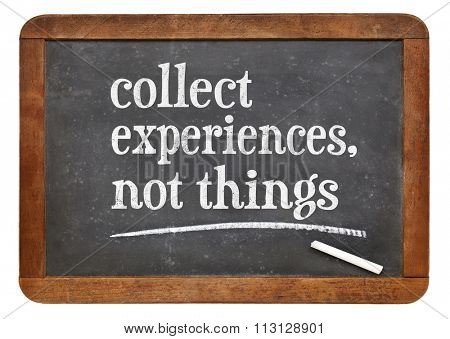 Collect experience, not things - inspirational advice or reminder  on a vintage slate blackboard