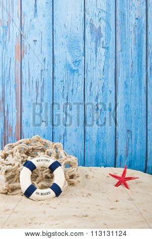 Lifebuoy with welcome at the beach