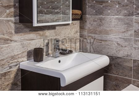 Detail Of Fashionable Bathroom - Sink And  Mirror