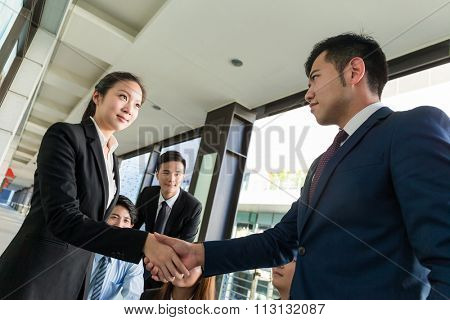 Group of business people hand shaking for making a deal