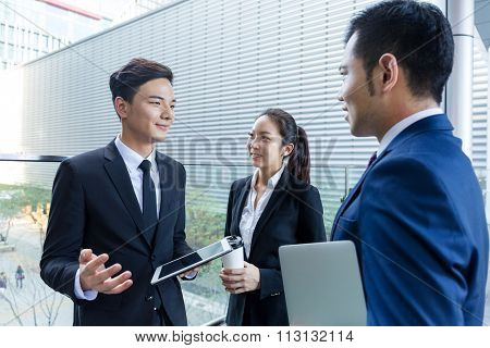 Group of business people talk to each other at outdoor