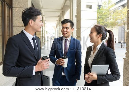 Group of business people talking to each other at outdoor
