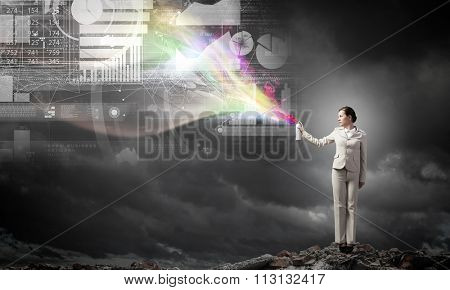 Young businesswoman spray infographs from aerosol balloon