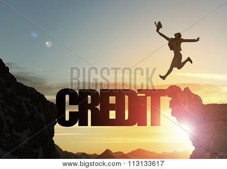 Businesswoman running on credit word bridge over precipice