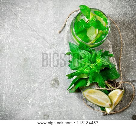 Cocktail Glass - Mint, Ice, Rum And Lime On A Stone Pedestal .