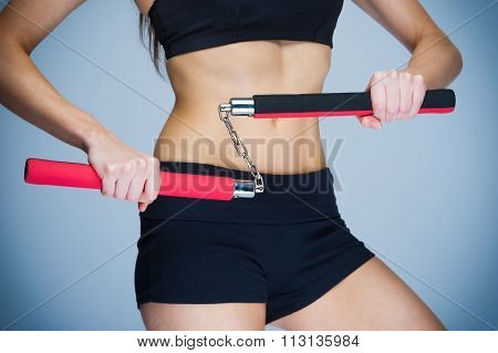 Woman Training With Nunchaku