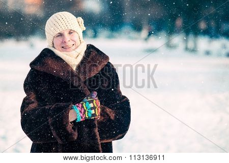 Winter Portrait Of Woman With A Snow Background
