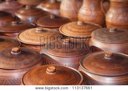 Many Clay Pots On The Table